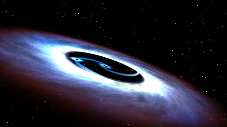Scoperti due buchi neri all'interno di un quasar